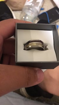 Silver-colored ring with box