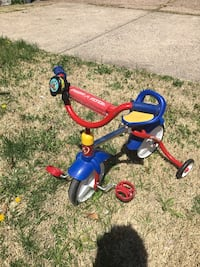 toddler's blue and red Radio Flyer trike