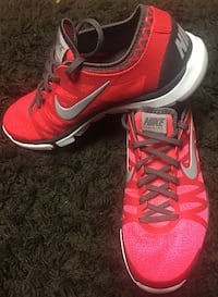 Pair of pink Nike training shoes, Never Worn size 9 Ames
