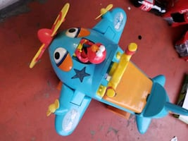 blue and yellow plastic toy in excellent  conditio