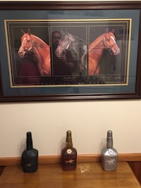 """Framed print """"Three for the Ages"""" Triple Crown Winners"""". 1973 Secretariat,1977 Seattle Slew,1978 Affirmed Print by Tony Leonard. Also 3 Bottles Of Makers Mark,Unopened with the name of each horse on the bottle.   Catlettsburg, 41129"""