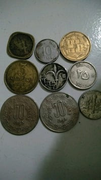 six round silver-colored coins Mumbai, 400709