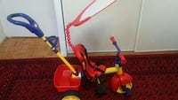 toddler's red and yellow tricycle 3 in 1