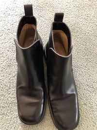Pair of black leather slip on shoes