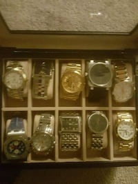assorted round analog watches with link bracelets