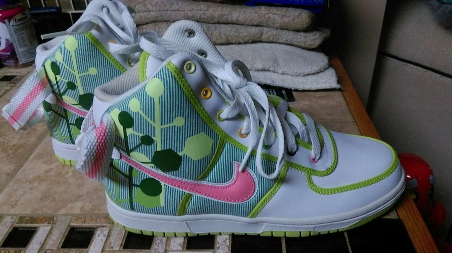 Photo Green blue white and pink nike high top sneakers