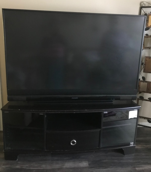 Used Mitsubishi Flat Screen 55 Inch With Black Wooden Tv Stand For
