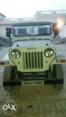 white Mahindra vehicle