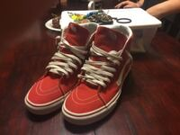 Red and white high top vans  null
