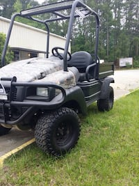 2010 Clubcar carryall 270. Lifted, LOW Hours, camo, dump truck backend, extra light bars top and bottom, new paint, negatives: chip in hood ($70) fix