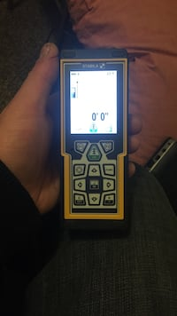 Rectangular yellow and black stabila digital wireless handheld device