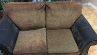 brown and black suede loveseat