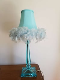 Aqua-colored, feathered lamp shade with lucite base