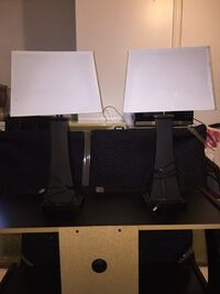 two black and white table lamps