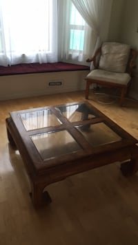 brown wooden framed glass top coffee table 3731 km