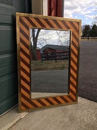 Beautiful mirror with faux wood/brass 30 x 42 x 1.  Pick up in Millwood, Va. Purcellville, 20132