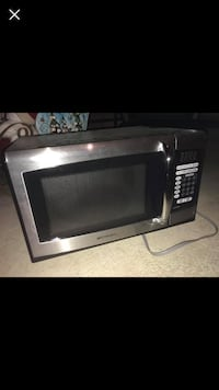 black and gray microwave oven 234 mi