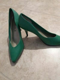 pair of green leather heels