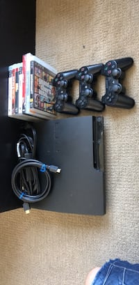 black Sony PS3 Slim with two controllers San Jose, 95112