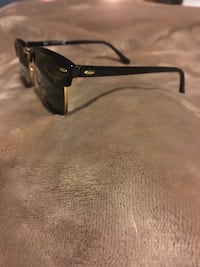 Black Ray Ban sunglasses with black frames gold rims Madison Heights, 48071