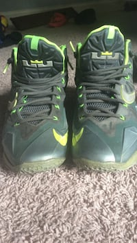 Pair of black-and-green LeBron James Nike basketball shoes size 8.5 Ballwin, 63011