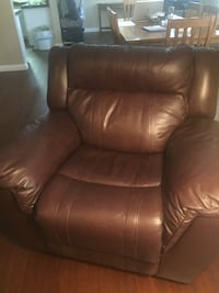Brown leather oversized recliner fully automatic. This chair will put you to sleep in a New York minute. Las Vegas, 89134