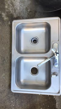 Gray metallic twin-tub sink with faucet