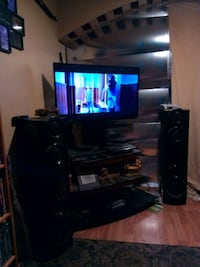 black flat screen TV with black wooden TV stand Springdale