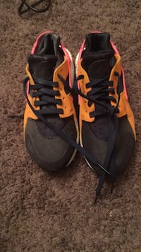 pair of black-and-orange Nike basketball shoes Washington, 20002