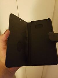 Svart smartphone flip window case
