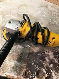 yellow and black corded angle grinder