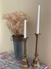 """SOLID BRASS candlesticks. Taller one is 12.5"""" tall and shorter one is 11"""" tall. $12 for BOTH!! Potomac, 20854"""
