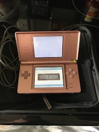 gold Nintendo DS with charger Nashua, 03060