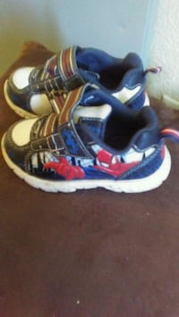 pair of white-and-blue Adidas sneakers Winnipeg, R2K 1P9