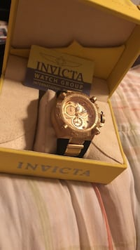round gold Invicta chronograph watch with link bracelet