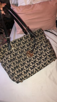 Used Black and brown michael kors monogram tote bag for sale in ... a31ffc0c64267