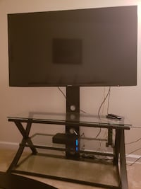 "Black TV stand with mount for TVs up to 60"" 29 km"