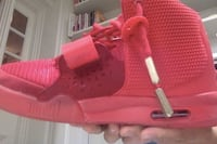unpaired red high-top sneaker