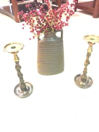 All four pieces two large cast iron candle holders PHILADELPHIA