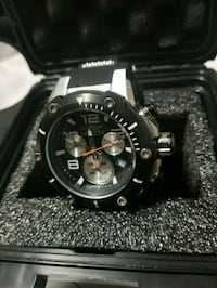 round black chronograph watch with link bracelet Longueuil, J4K 1C2