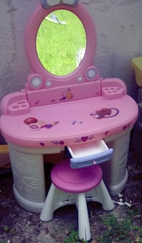 pink and white plastic vanity table Sarasota