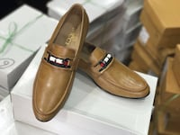 pair of brown leather gucci slip-on shoes New Delhi, 110041