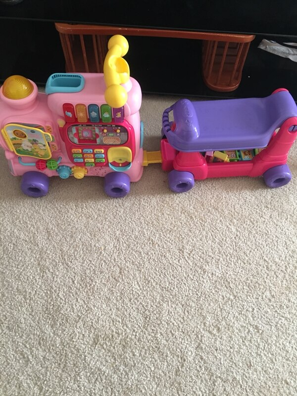 toddler's pink and purple ride on toy car
