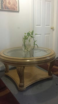 Round top clear glass table with brown wooden base Boston, 02128