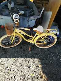 yellow and white cruiser bike