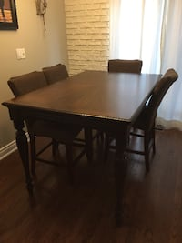 Solid wood bar table , insert is inside table opened up to seat 8