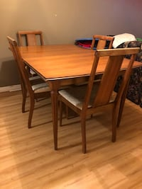 rectangular brown wooden table with four chairs dining set Whitby, L1R 0A8