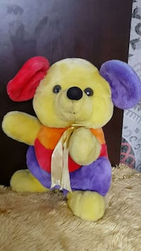 yellow purple and red bear plush toy