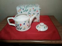 white and multicolored floral ceramic teapot with  Laureldale