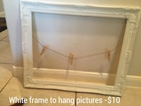 squared white wooden photo frame
